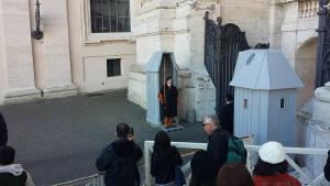 This is a picture of some tourists taking pictures of the Swiss Guard