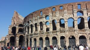 The outside of the Colosseum - the pillars are riddled with holes
