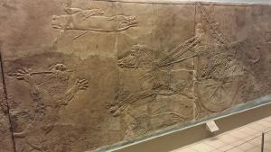 Assyrian Lion Hunt reliefs. Apparently they shot one of the lions out of midair