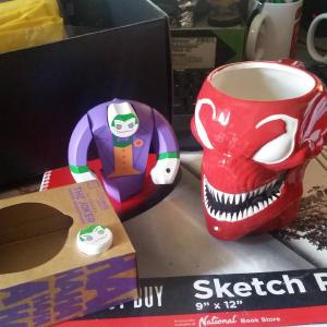 I got this villains lootcrate back when I was in London, only opened it now. It has this weird wooden joker and this creepy carnage mug. There's also a hydra pin and a breaking bad apron in the box