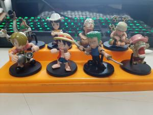 Posted on r/OnePiece: Found these in storage from years ago. Forgot where I got them. IDK why Luffy has a stick.